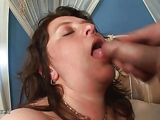 Chubby Mama Getting Her Tits Covered with Young Cum