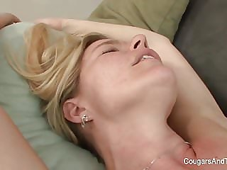 Blonde MILF Gets Licked by Her Stepdaughter on the Couch