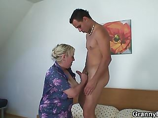 Moaning Granny Rides His Young Cock