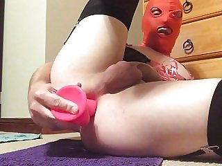 Hooded Sissy in Lingerie Fucks Ass with Pink Dildo