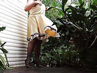 Sissy Ray in Gold Sissy Dress on Windy Day 2