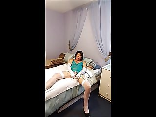Sissy Roberta Bryan in a Blue Dress and Dildos