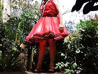 Sissy Ray in Red Taffeta Dress on Windy Day