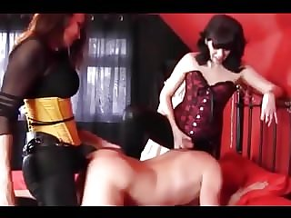 Two Dommes Use a Sissy