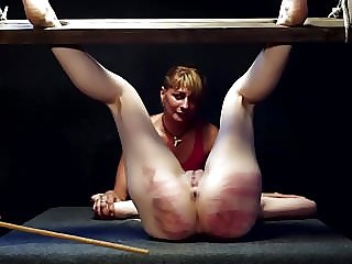 Merciless Caning for Blonde and Her Girlfriend