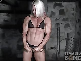 Female Bodybuilders Muscles Strain Against Chains